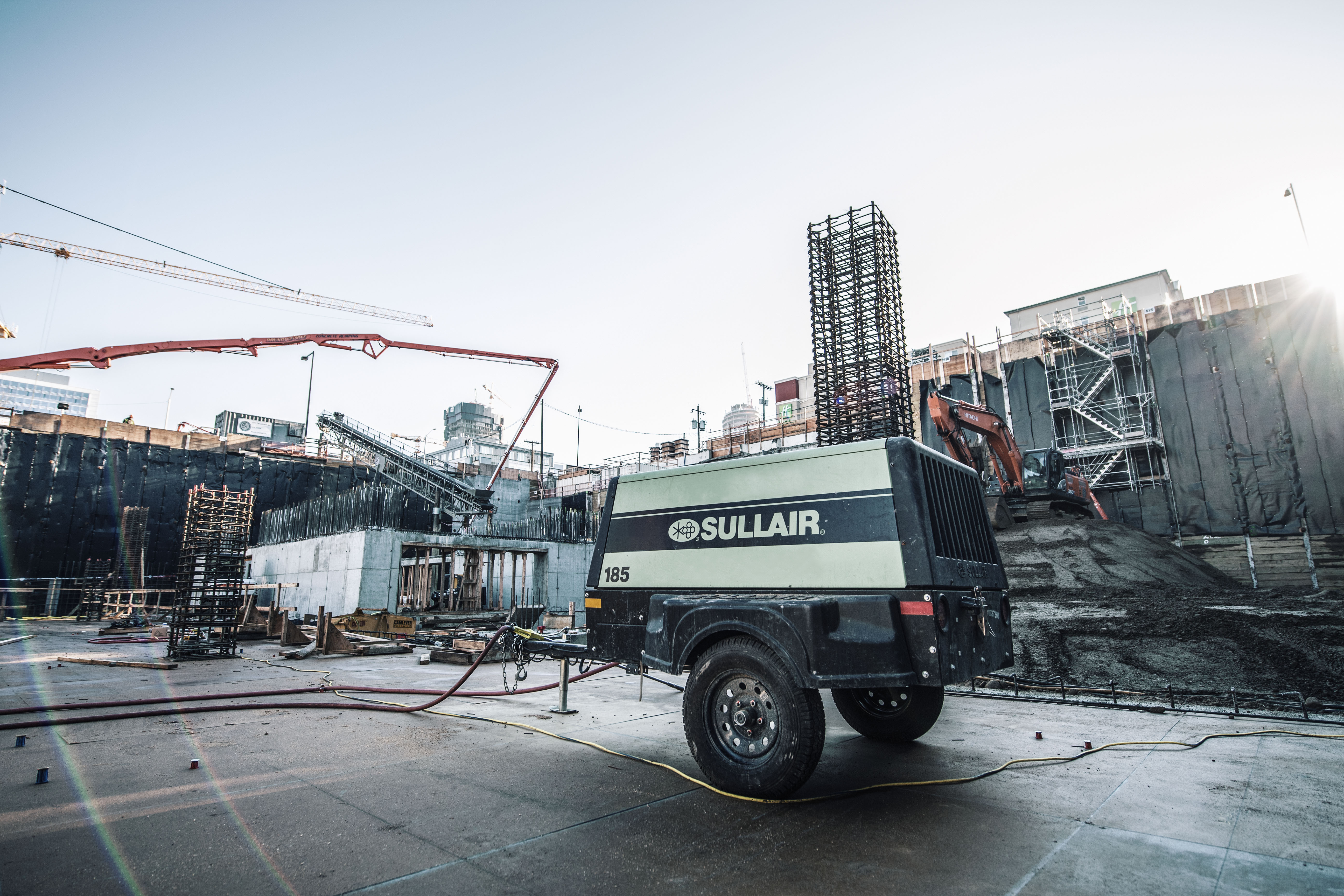 Sullair 185 cfm portable compressor on a jobsite in Seattle